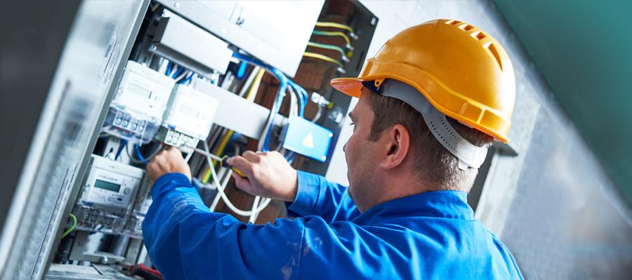 bigstock-Electrician-installing-energy-145004402-900x400